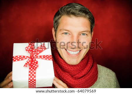 Curious man holding present voucher for christmastime