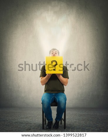 Curious man sitting on a chair looking cautious inside a mysterious yellow box as a magic light comes out. Unknown surprise concept as a question mark drawn on the bin.
