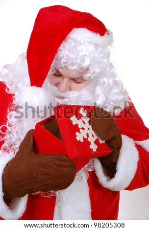 curious santa clause opens a present