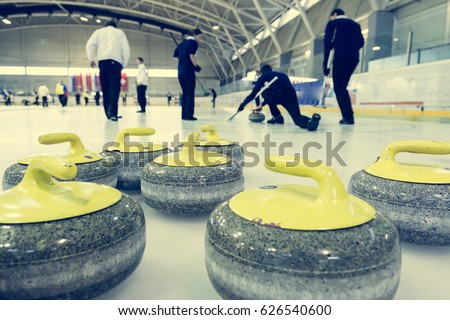 Curling stone on a game sheet.