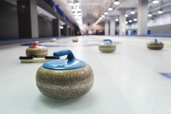 Curling stones lined up on the playing field