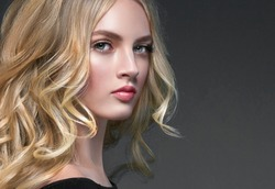 Curly blonde hair woman portrait