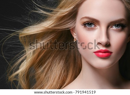 Curly blonde hair woman portrait