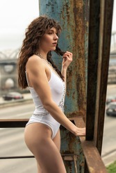 Curly girl in a white bodysuit