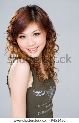 stock photo : curly hair asian woman with happy smile