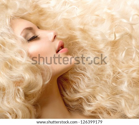 Curly Hair. Fashion Girl With Healthy Long Wavy Hair. Beauty Blonde Woman Portrait. Blond Hair, Hair Extension, Permed Hair