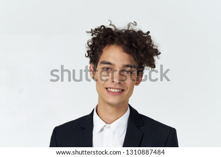 curly head man in a suit, cropped look       #1310887484