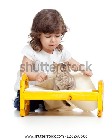 curly kid girl playing with kittens