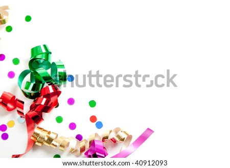 Curly ribbon and confetti on a white background with copy space