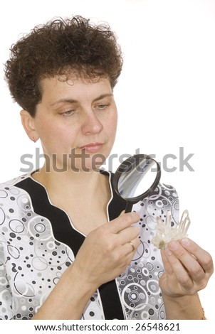 magnifying devices. makeup. models curly woman with magnifying glass