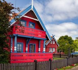 Curonian Spit. Nida. The colorful wooden houses.  Picture of Nida, Lithuania. Wood facade.