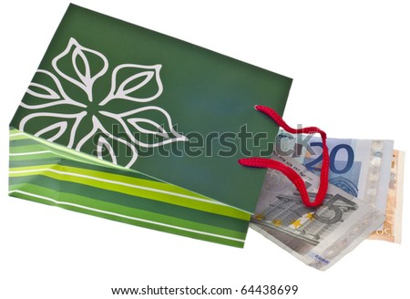 Currency in a Holiday Gift Bag Holiday Spending Concept Isolated on White with a Clipping Path.