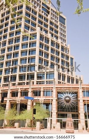 Current Phoenix Arizona City Hall in Downtown showing  the star burst symbol. - stock photo