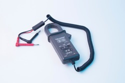 Current transducer. Current clamp. A tool for measuring electric current.