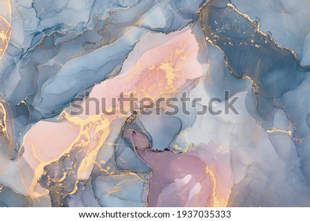 Currents of translucent hues, snaking metallic swirls, and foamy sprays of color shape the landscape of these free-flowing textures. Natural luxury abstract fluid art painting in alcohol ink technique Stock fotó ©