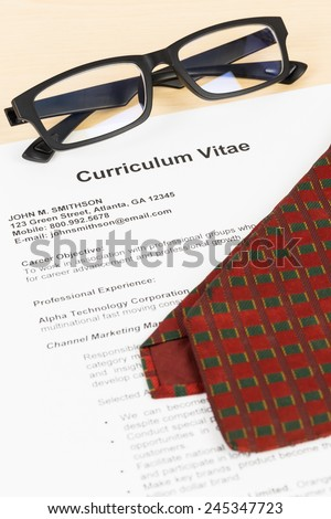 Curriculum vitae or CV with glasses, and neck tie; concept job applying
