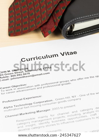 Curriculum vitae or CV with organizer and neck tie; concept job applying