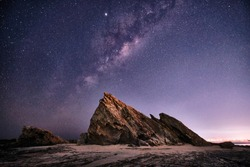 Currumbin rock with the Milky Way behind with lots of star on the Gold Coast, Queensland, Australia