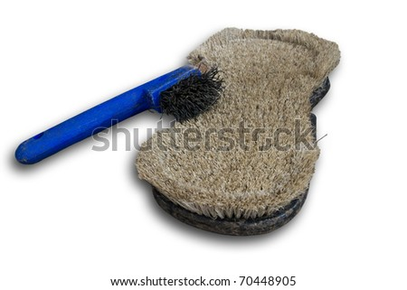 Curry comb and horseshoe scratcher isolated with little shadow