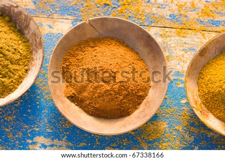 Curry powder in bowls, overhead view - stock photo