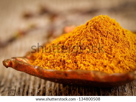 Curry powder in small vintage container