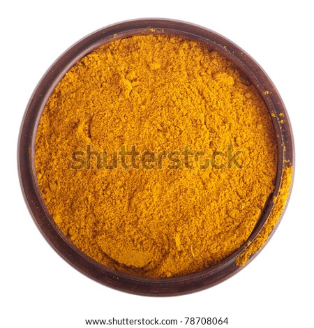 curry powder, mix of indian spices on a vintage wooden bowl (isolated on white background)