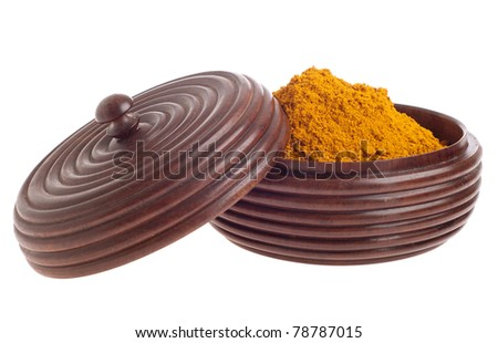 curry powder, mix of indian spices on a vintage wooden bowl (isolated on white background) - stock photo