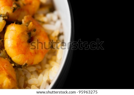 Curry Prawns with Rice - Macro and Black background