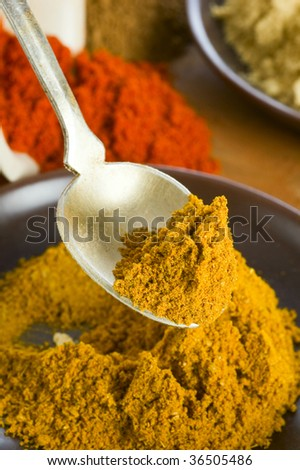 curry spice in spoon - stock photo
