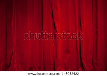 Curtain from the theater with a spotlight as background
