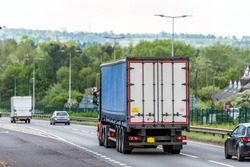 curtain side lorry truck on uk motorway in fast motion