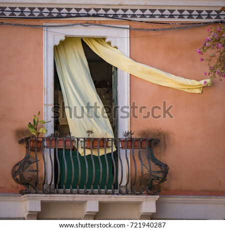 Curtains blow in the wind out onto a balcony in Taorimina Sicily #721940287 : wind curtain for canopy - memphite.com
