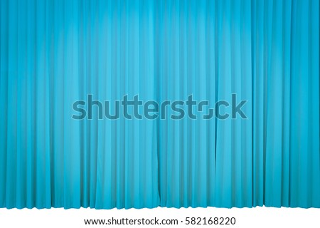 Curtains object blue velvet drapes representing theatrical entertainment stage isolated on a white background with clipping path