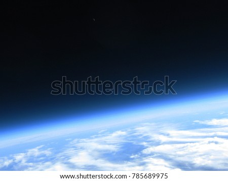 Curvature of the earth and crescent moon in single shot taken from a high altitude balloon flight to the stratosphere #785689975