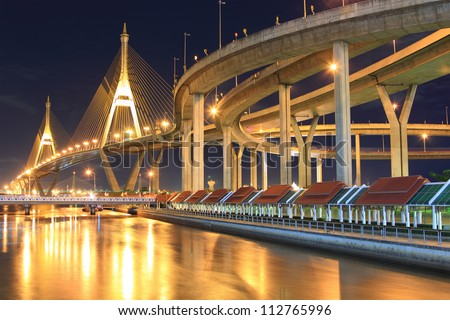 Curve of suspension bridge at riverside in twilight scene(Bangkok, Thailand) #112765996