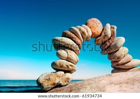 Curve of the pebbles on the sea coast