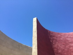 curved concrete wall vertex against blue sky