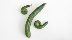 curved cucumber forming a percent sign