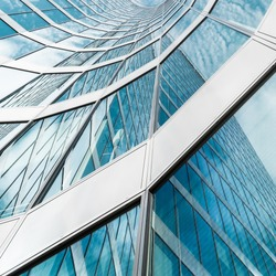 Curved diagonal perspective lines - abstract office architecture detail background with modern glass windows on a skyscraper  - square layout
