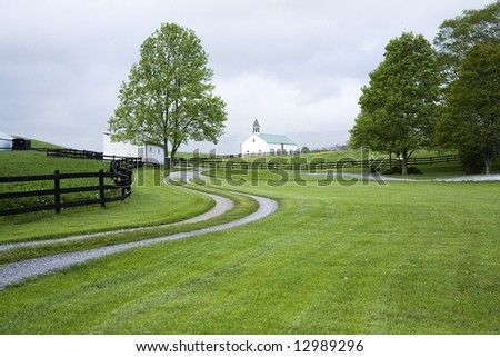 Curved driveway leading to a distant church in Marlinton West Virginia.