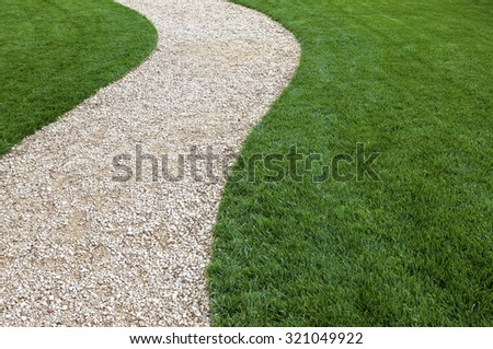 Curved garden path with fresh green cultivated lawn
