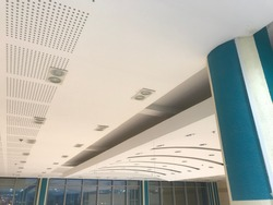 Curved Gypsum false ceiling designs of an buildings like shopping mall public building interiors and architecture painted with emulsion painted smooth matt finish
