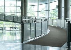 Curved hallway in building. Indoor walkway  interior in modern office corridor. Architecture way for universal design.