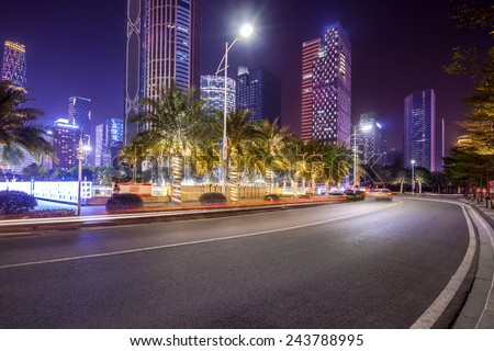 curved light trails on the city road in guangzhou central business district with modern buildings at night