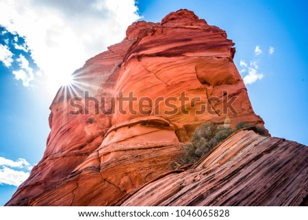 Curved Red Rocks in South Coyote Buttes, Vermilion Cliffs, Arizona, USA. Coloured sandstone rocks with rays of light. Sloping sandstone slopes with striped walls in the Wave popular area.