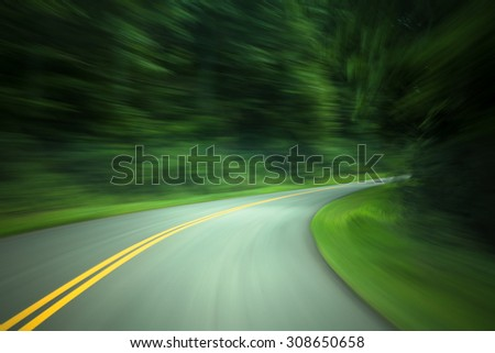 Curved road through country road with motion blur
