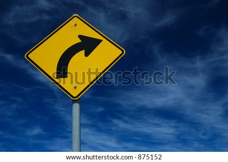 Curved Road Traffic Sign over blue sky