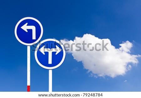 Curved Road Traffic Sign over blue sky,turn left