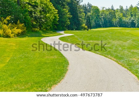 Curved sidewalk, path, trail at the empty street. Neighborhood scenery. - Shutterstock ID 497673787