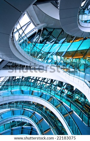 Curved staircase in big glass office building